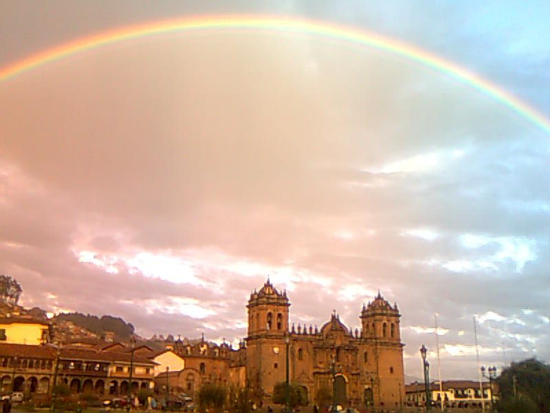 rainbow over the main cuzcu plaza de armas